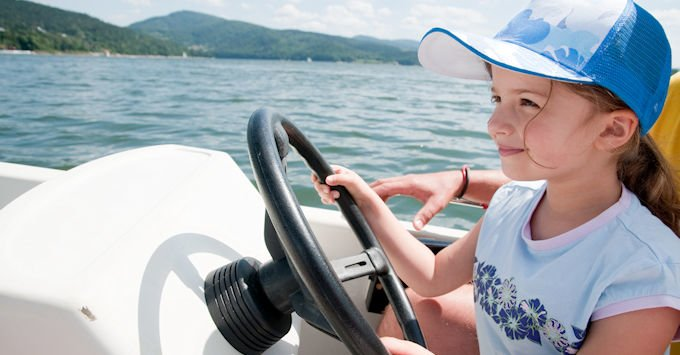 girl driving boat